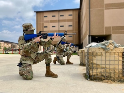 Trainees in basic military training (BMT) learn defensive fighting positions in preparation for BEAST (Basic Expeditionary Airman Skills Training) on Joint Base San Antonio-Lackland, Texas, April 8. This was the first day mask wear was implemented at BMT as a required safety measure during the COVID-19 pandemic.