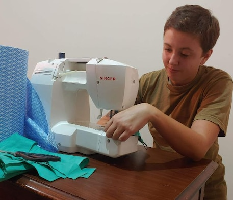 Staff Sgt. Kalynn Mitchell using a sewing machine.