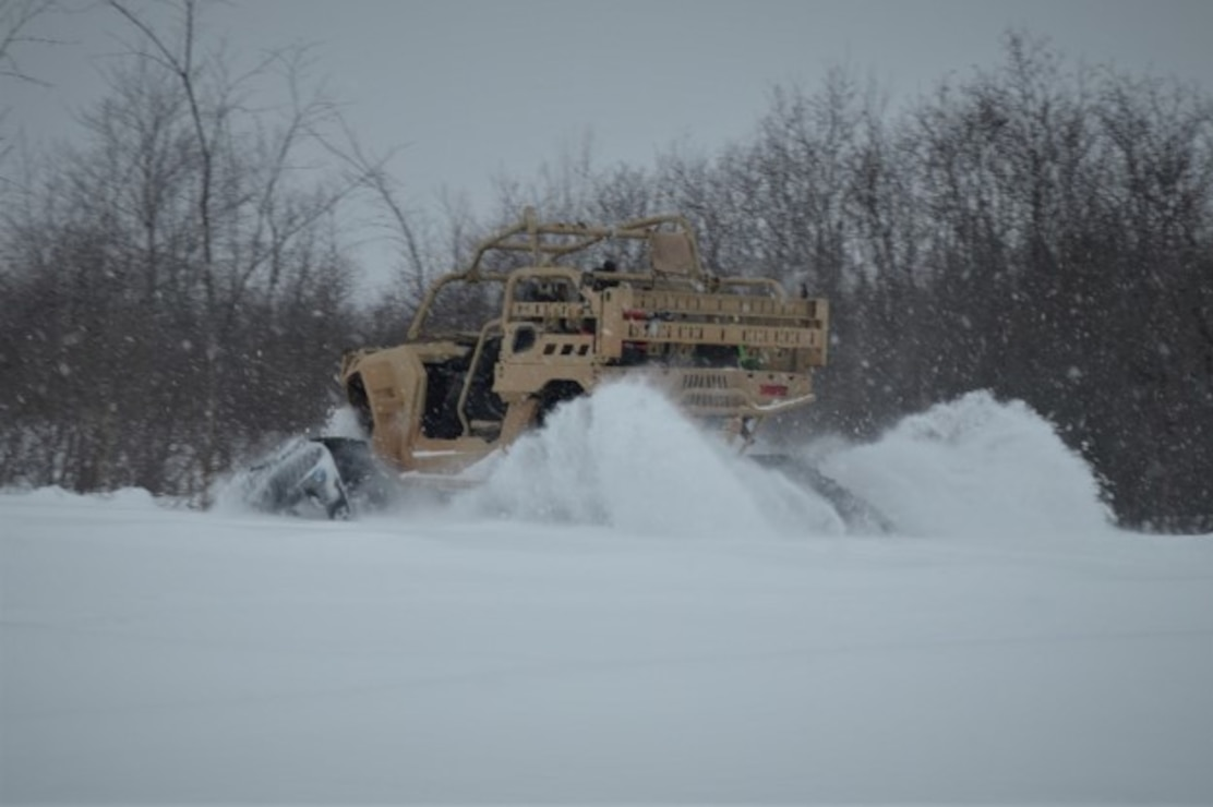 Vehicle in thick snow.