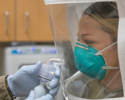 Staff Sgt. Beth Kenney, 56th Dental Squadron dental assistant, wears a N95 respirator mask while misted with a sensitivity and fit test solution April 1, 2020, at Luke Air Force Base, Ariz.