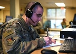 Staff Sgt. Walter Ramos, crew chief, 157th Air Refueling Wing, New Hampshire Air National Guard, fields calls for unemployment benefits at a makeshift call center at the state fire academy in Concord, April 7, 2020. Ramos, originally from Puerto Rico, handles all applicants in need of a  Spanish speaker to help with claims.