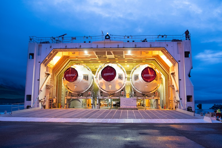 The hatch opens on a United Launch Alliance barge, known as the RocketShip, revealing Delta IV Heavy boosters April 5, 2020, at Vandenberg Air Force Base, Calif. The barge docked at Vandenberg AFB to offload Delta IV Heavy boosters for an upcoming launch scheduled to occur later this year. The barge operation is a vital first step to executing the mission of assured access to space. (U.S. Air Force photo by Senior Airman Aubree Owens)