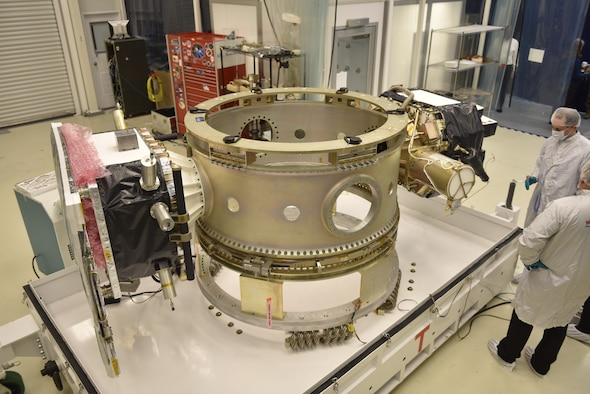 photo of a large piece of satellite equipment in a laboratory