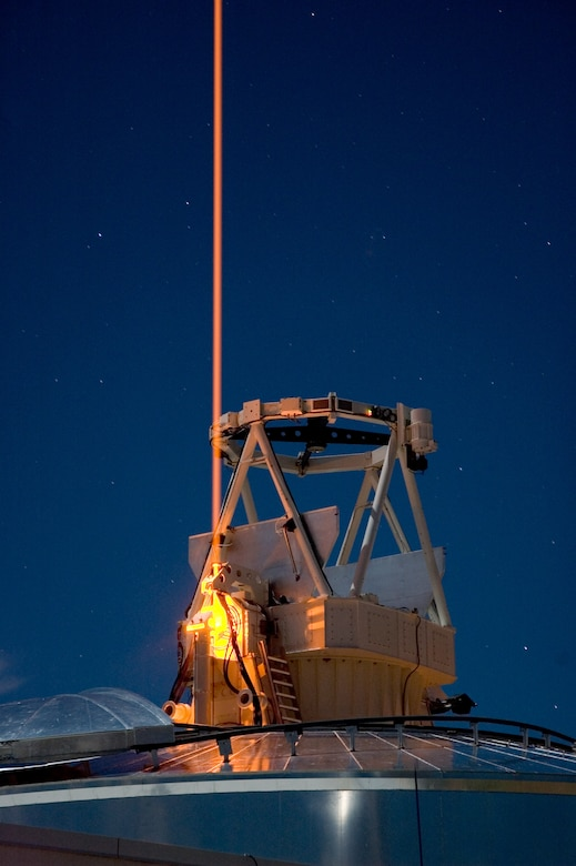photo of a high tech piece of equipment pointed to the night sky