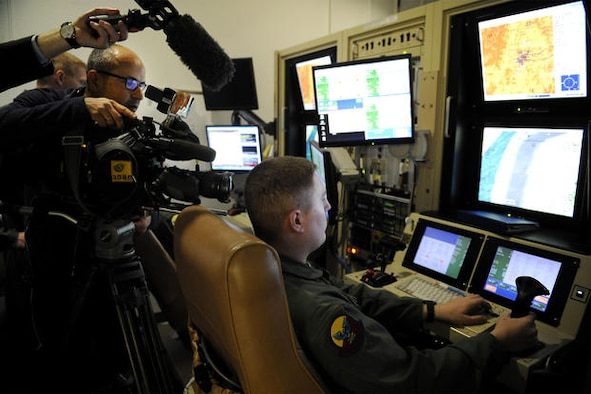 Local and international media outlets film a US Air Force sensor operator inside the 16th Training Squadron MQ-1/MQ-9 simulator at Holloman AFB, which served as a training base for crews of the MQ-1 Predator and the MQ-9 Reaper.