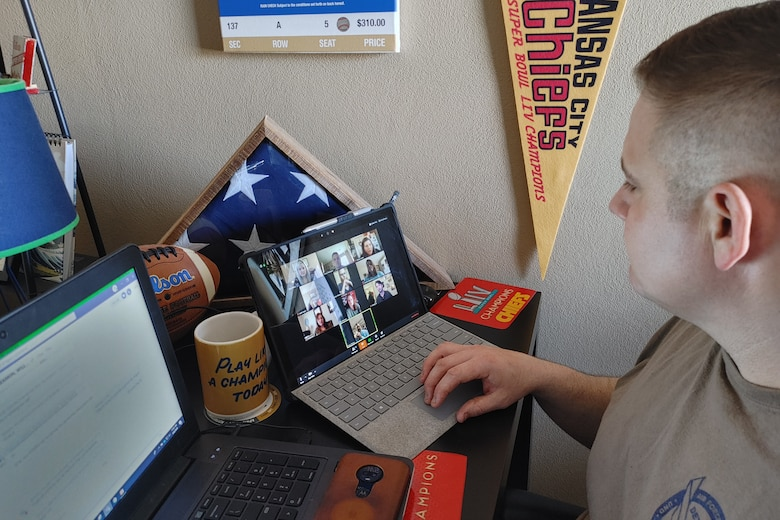 U.S. Air Force Maj. James Thompson, 763rd Specialized Contracting Squadron deputy director, hosts a video teleconference with team mates to talk through recent COVID-19 emergency support to Air Mobility Command.