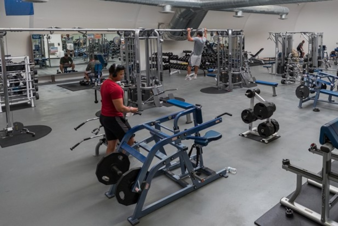 Airmen from Edwards Air Force Base, California, work out at the base gymnasium, maintaining appropriate physical distance, April 7.