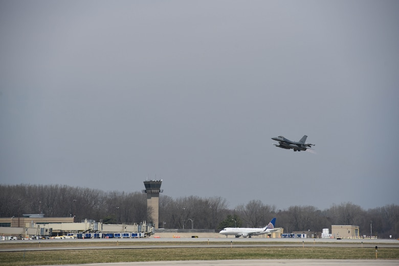 An F-16 Fighting Falcon from the 115th Fighter Wing takes off at Dane County Regional Airport, Madison, Wisconsin April 7, 2020.