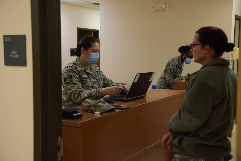 Tech. Sgt. Adriana Dunaway, 514th Force Support Squadron, personnel support for contingency operations, assists a service member on deployment readiness process at Joint Base McGuire-Dix-Lakehurst, N.J., April 5, 2020. Guard and Reserve service members will depart to New York City in support of the DoD response to combat the spread of COVID-19. U.S. Northern Command, through U.S. Army North, is providing military support to the Federal Emergency Management Agency to help communities in need. (U.S. Air Force photo by Airman 1st Class Briana Cespedes)