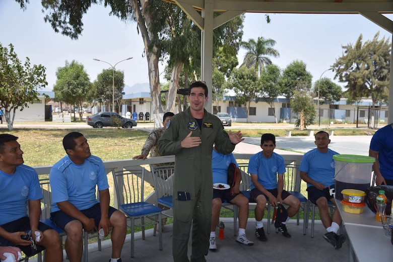 Peruvian Air Force Lt. Alfonso Reyes gives a short speech thanking instructors from the 571st Mobility Support Advisory Squadron at Callao Air Base in Lima, Perú. The 571st MSAS is a language enabled squadron of air advisors who assess, train, advise and assist Latin American and Caribbean partner nations in the development of their airpower capabilities as part of the U.S. Air Force's and Air Mobility Command's enduring building partner capacity mission. (courtesy photo)