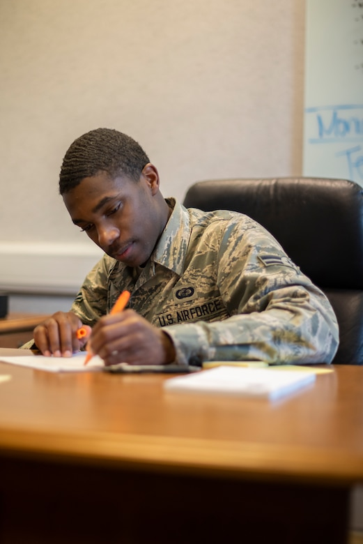 Airman 1st Class Tyran Stokes, 100th Wing Staff Agencies unit control center representative, confirms that accountability of isolated and quarantined Airmen has been completed for all wing staff agencies April 8, 2020, at RAF Mildenhall, England. Unit control centers report information that is routed up multiple levels through the chain of command, so their numbers must be accurate. (U.S. Air Force photo by Airman 1st Class Joseph Barron)