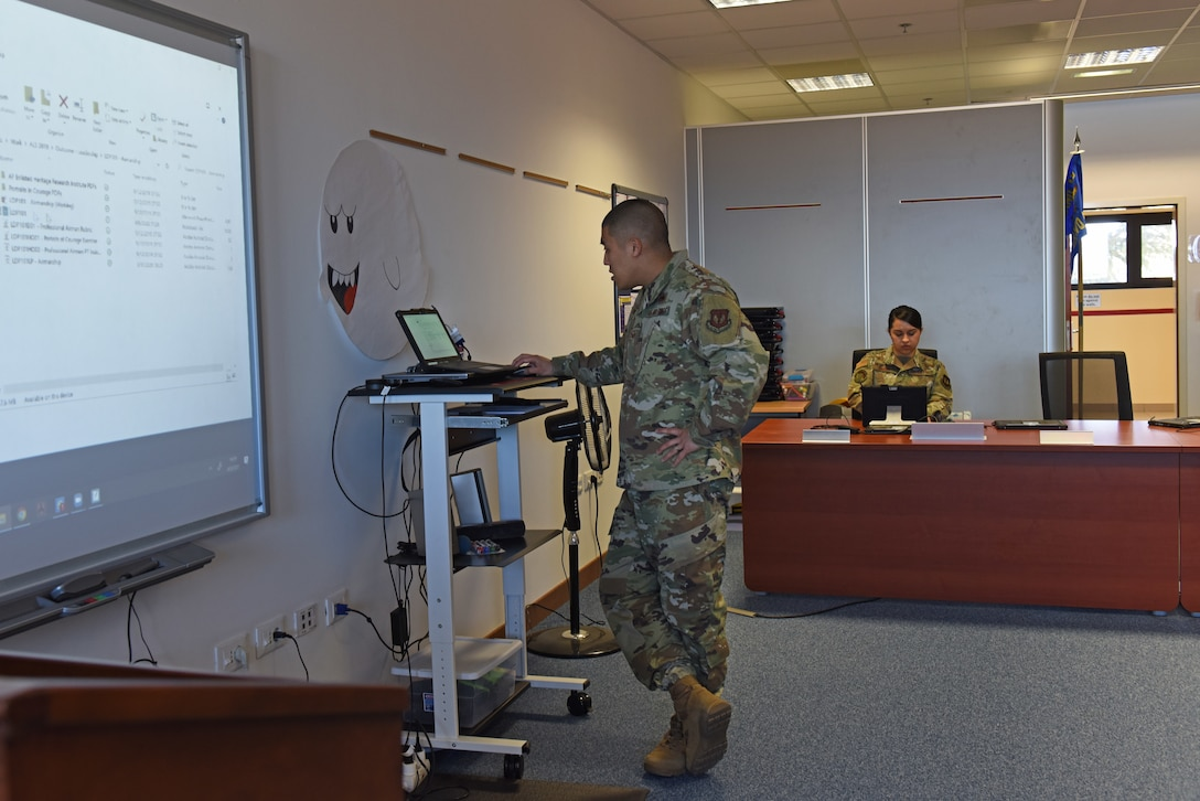 Air Force Staff Sgt. Justin Bow and Air Force Staff Sgt. Krystal Lindsey, instructors at the Tech. Sgt. Adam K. Ginett Airman Leadership School, run through practice lessons in preparation for a virtual ALS course at Aviano Air Base, Italy, April 9, 2020. A few lessons were modified but students will still be able to meet lesson intent as directed by the Barnes Center Instruction and will still be able to participate in guided discussions. (U.S. Air Force photo by Staff Sgt. Valerie Halbert)