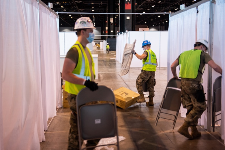 Members of the Illinois Air National Guard assemble an alternate care facility at the McCormick Place Convention Center in Chicago April 8, 2020. Sixty Guard members were activated to support the US Army Corps of Engineers and the Federal Emergency Management Agency to set up the facility for COVID-19 patients with mild symptoms who do not require intensive care.