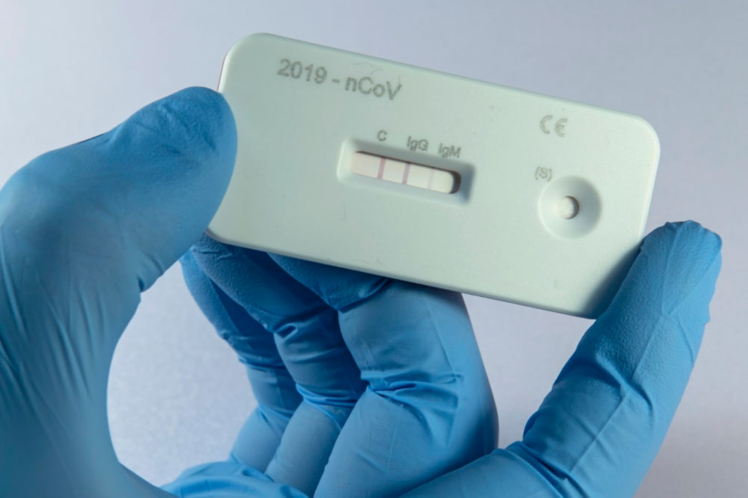 A scientist presents an antibody test for coronavirus in a laboratory of the Leibniz Institute of Photonic Technology