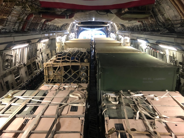 Disaster Relief Bed-Down Sets are loaded on to a C-17 Globemaster III aircraft at the 156th Airlift Wing, Puerto Rico Air National Guard unit, March 24, 2017. The wing flew two C-17's to Puerto Rico to load and transport two DRBS's to the 200th RED HORSE Squadron in Mansfield, Ohio. The DRBS's were deployed to Puerto Rico after an earthquake there in January.