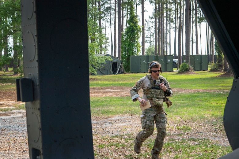 TACP officer runs while talking on the radio