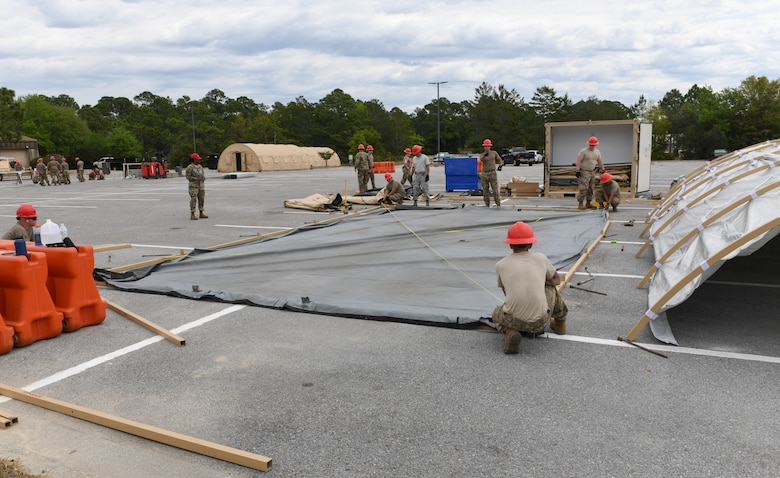 RED HORSE Squadron set up a tent frame