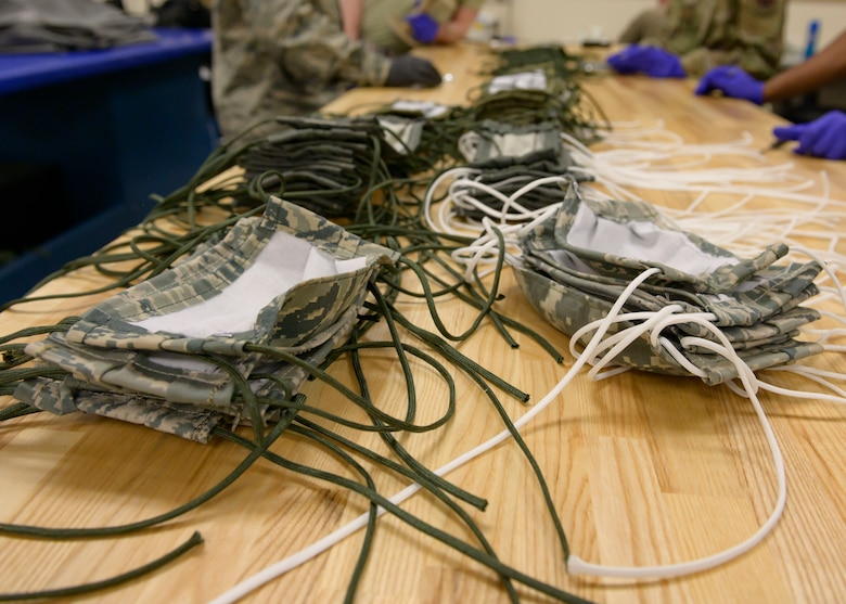 Masks made by the 366th Operations Support Squadron lay on a work table after production, March 20, 2020, at Mountain Home Air Force Base. These mask are made for people on base and help to prevent the spread of COVID-19. (U.S. Air Force photo by Senior Airman Tyrell Hall)