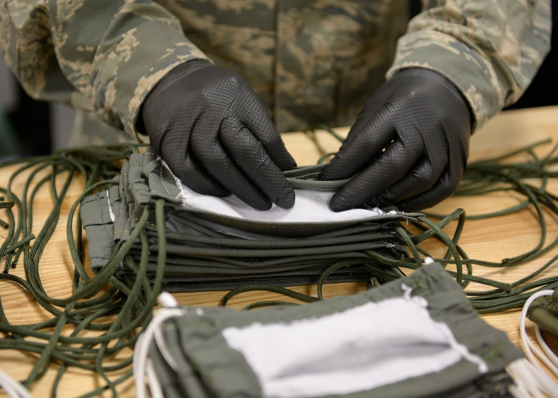 Airmen from the 366th Operations Support Squadron, craft masks for personnel on base, March 20, 2020, at Mountain Home Air Force Base, Idaho. These masks are designed in a multi-layer style to further deter the spread of CVOID-19. (U.S. Air Force photo by Senior Airman Tyrell Hall)