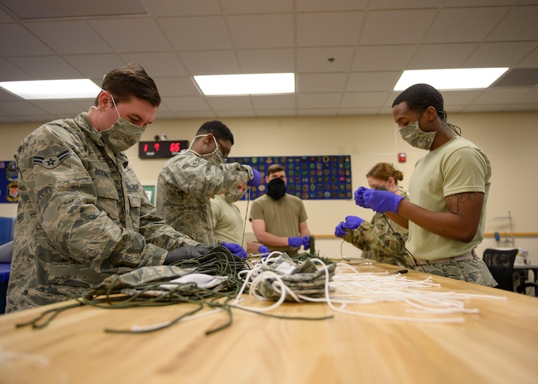 Airmen from the 366th Operations Support Squadron, craft masks for personnel on base, March 20, 2020, at Mountain Home Air Force Base, Idaho. These masks are designed in a multi-layer style to maintain a proper barrier. (U.S. Air Force photo by Senior Airman Tyrell Hall)