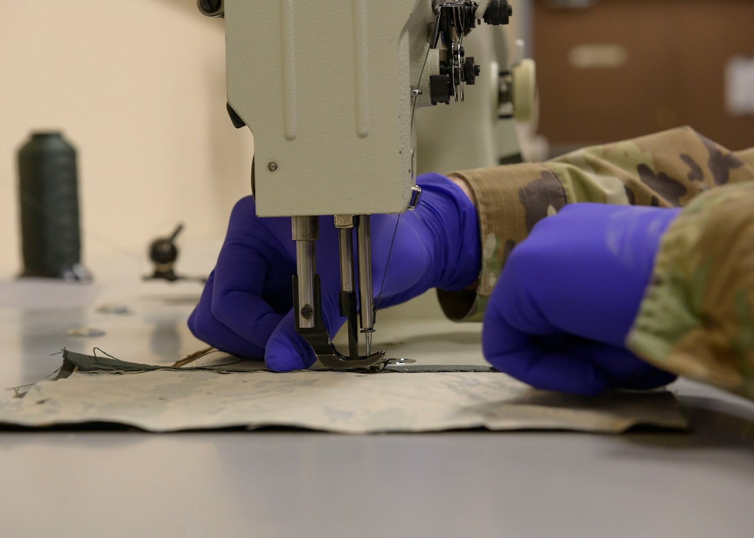 Airmen from the 36th Operations Support Squadron craft cloth masks, March 8, 2020, at Mountain Home Air Force Base. Amid the CVOID-19 pandemic, these masks will serve to prevent the spread of the virus while maintaining social distancing. (U.S. Air Force photo by Senior Airman Tyrell Hall)