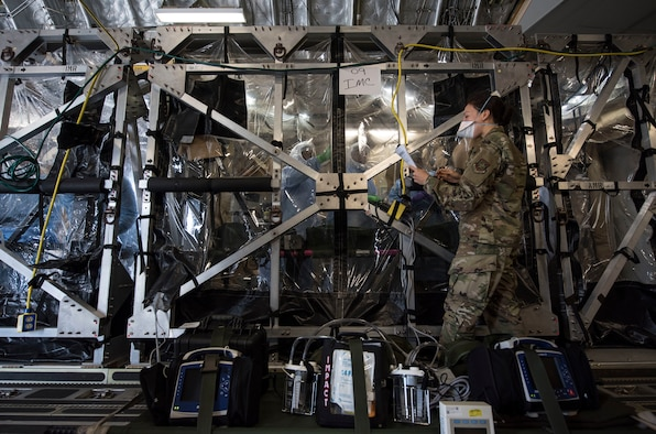 Capt. Naomi King, 628th Operational Medical Readiness Squadron infectious disease team lead, reviews COVID-19 cleaning procedures with Airmen in the Transport Isolation System at Joint Base Charleston, S.C., April 5, 2020.