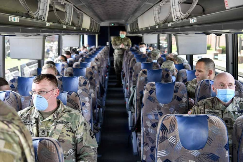 Medical personnel on a bus.