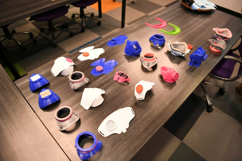 Facemask prototypes rest on a table at the SparkX Cell Innovation and Idea Center on Joint Base Andrews, Md., Apr. 8, 2020. There have been more than five different prototype designs made from multiple different materials. (U.S. Air Force photo by Airman 1st Class Spencer Slocum)