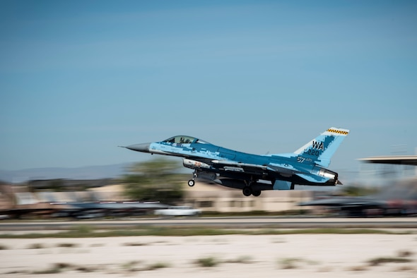 An F-16 Fighting Falcon fighter jet takes off.