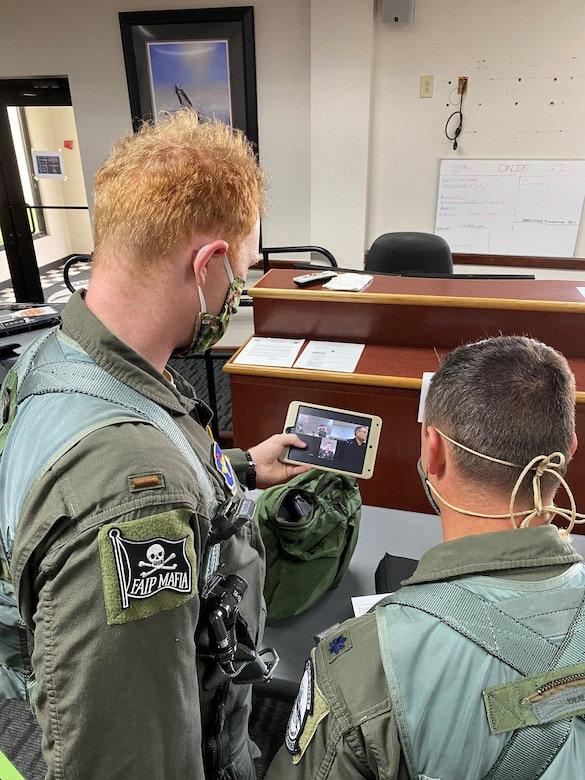 Second Lt. Frank Toohey and 559th Flying Training Squadron instructor pilot Lt. Col. Dan Healey recieve a brief from operations superintendent Lt. Col. John Urso and Jeff Madison of the 12th Operations Support Squadron.