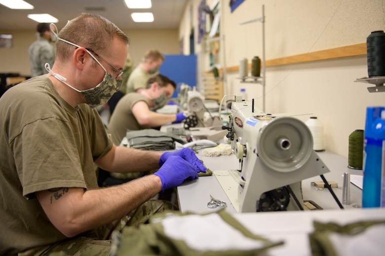 Master Sgt. Douglas Reedy, 366th Operations Support Squadron Aircrew Flight Equipment flight chief, sews cloth masks together, March, 7, 2020, at Mountain Home Air Force Base. All hands were on deck to craft over 500 cloth masks for personnel on base. (U.S. Air Force photo by Senior Airman Tyrell Hall)