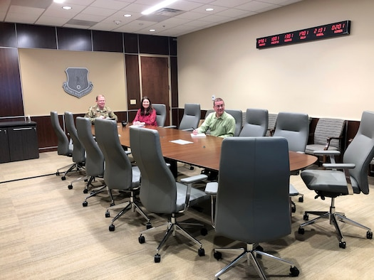 Left to right, Lt. Gen. Richard Scobee, Air Force Reserve Command commander, his wife, Janis, and Jim Woodyard, from AFRC's Manpower, Personnel and Services Directorate, participate in the quarterly meeting of AFRC's Community Action Board