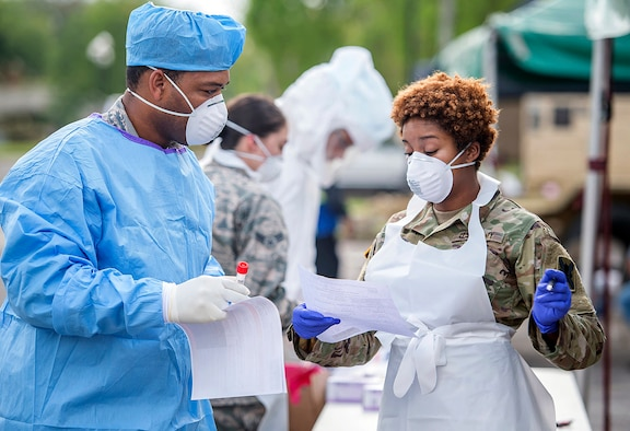 Louisiana National Guard Soldiers and Airmen collect nasal swabs from patients during a drive-through, community-based COVID-19 testing site in New Orleans March 20, 2020. More than 28,000 National Guard members have been mobilized throughout the country as part of COVID-19 response efforts, with additional Soldiers and Airmen expected to come on duty in the coming weeks.