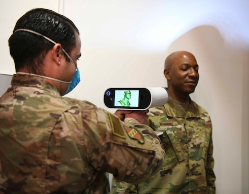 Staff Sgt. Carlos Rodriguez, 11th Wing SparkX innovation technician, scans the face of Chief Master Sgt. Kaleth O. Wright, Chief Master Sgt. of the Air Force, for a 3D model at the SparkX Cell Innovation and Idea Center on JBA, Md., Apr. 10, 2020. Wright's face was 3D modeled for a custom fit mask, which was printed to show 3D facemask printing capability. All individuals on Department of Defense property, installations and facilities must wear face coverings when they cannot maintain six feet of social distancing. (U.S. Air Force photo by Airman 1st Class Spencer Slocum)