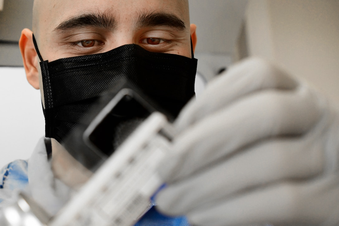 U.S. Air Force Tech. Sgt. Jordan Rigor, 48th Medical Support Squadron, conducts COVID-19 testing at Royal Air Force Feltwell, England, April 9, 2020. The capability to test locally has reduced the wait time for results from 5-7 days to less than 24 hours. (U.S. Air Force photo by Master Sgt. Matthew Plew)