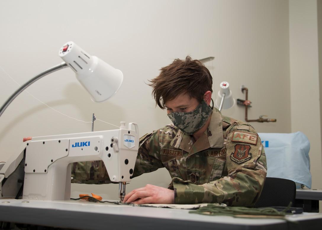 Senior Master Sgt. Megan Kuszewski, 459th Operations Support Squadron, sews together a face mask at Joint Base Andrews, Maryland. (Staff Sgt. Cierra Presentado)