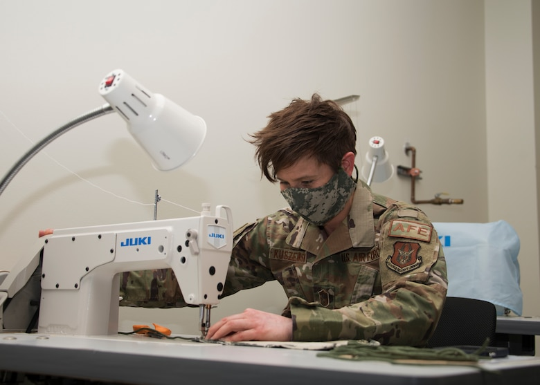 Senior Master Sgt. Megan Kuszewski, 459th Operations Support Squadron, sews together a face mask at Joint Base Andrews, Maryland. (Staff Sgt. Cierra Presentado)