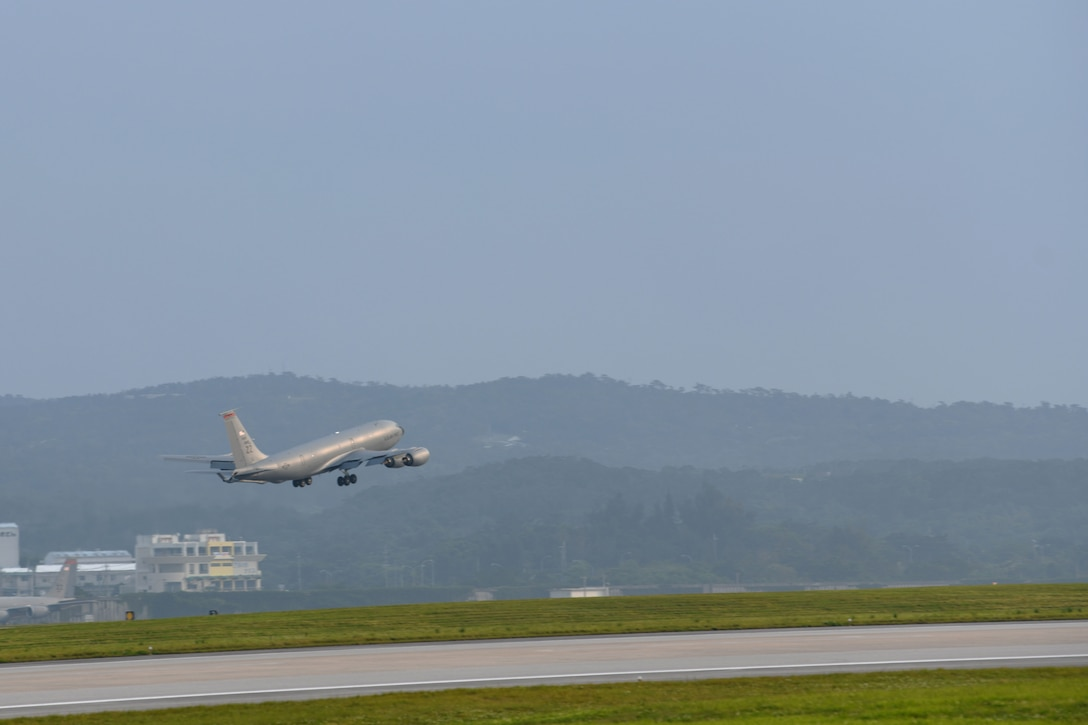A U.S. Air Force KC-135 Stratotanker, assigned to the 909th Air Refueling Squadron, takes off April 9, 2020, at Kadena Air Base, Japan. Team Kadena is postured to protect its forces against COVID-19 while also maintaining mission readiness in support of the U.S.-Japan Alliance. The 909th ARS conducts aerial refueling missions throughout the region ensuring a free and open Indo-Pacific. (U.S. Air Force photo by Airman 1st Class Rebeckah Medeiros)
