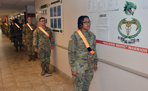 Soldiers maintain social distancing.