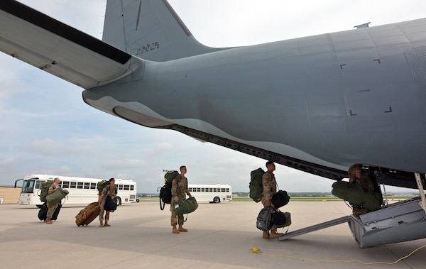Soldiers board aircraft.