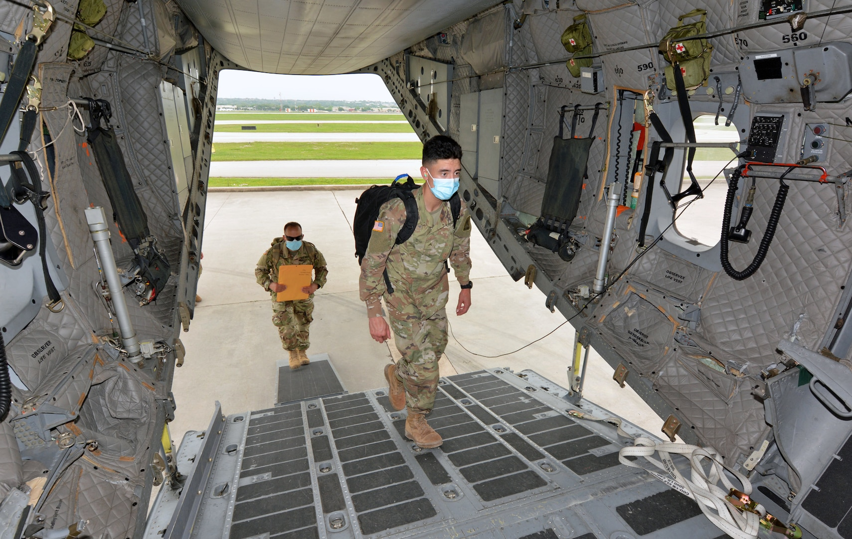 Soldiers board aircraft