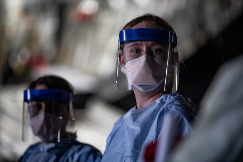 A U.S. Air Force medical Airman awaits patient documentation      following the first-ever operational use of the Transport Isolation System at Ramstein Air Base, Germany, April 10, 2020. The TIS is an infectious disease containment unit designed to minimize contamination risk to aircrew and medical attendants, while allowing in-flight medical care for patients afflicted by a disease--in this case, COVID-19. (U.S. Air Force photo by Staff Sgt. Devin Nothstine)