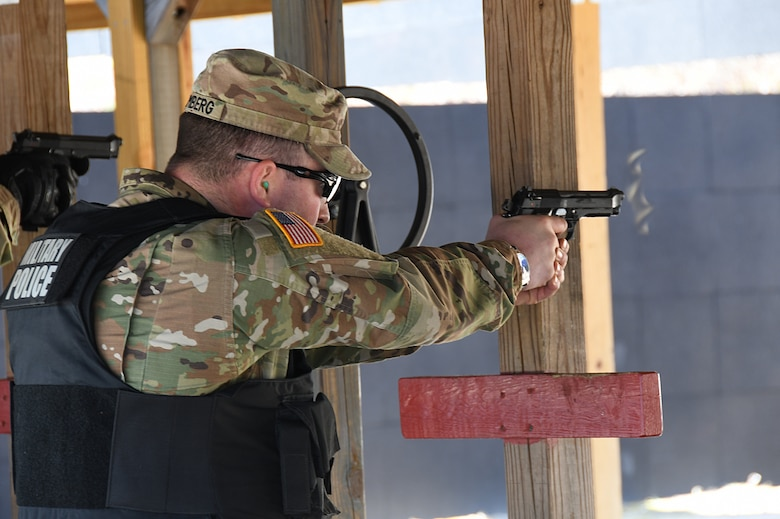 Spc. Eugene Bromberg, 1-182nd, Bravo Company Infantryman in the Massachusetts National Guard and a civilian Iron Worker, shoots an M9 at the 104th Fighter Wing range. The 104th Fighter Wing Combat Arms Training and Maintenance Instructor ensures the Infantrymen from 1st Battalion, 182nd Infantry Regiment, Bravo Company are currently qualified on the M9 pistol. The Massachusetts National Guard Infantrymen are activated in response to COVID-19 to ensure there is enough manpower available to safeguard the 104th Fighter Wing assets and personnel. These precautions are being taken to mitigate any manning shortages that may occur due to unforeseen illness and will allow back up for the wing's Security Forces. During the pandemic, the infantrymen will be working alongside the 104th Security Forces to reinforce security for the 104th Fighter Wing F-15 homeland defense flying mission to maintain air superiority. (U.S. Air National Guard Photo by Senior Master Sgt. Julie Avey)