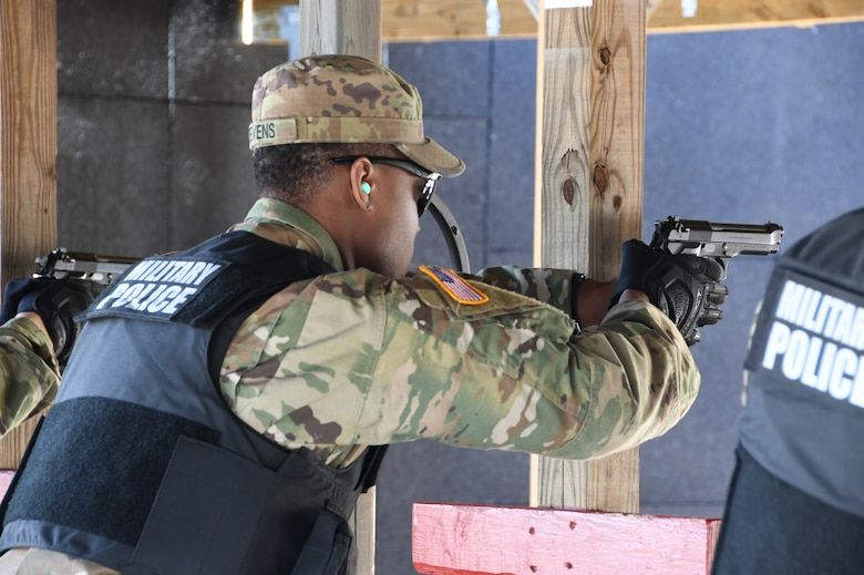 Spc. Michael Stevens, 1-182nd, Bravo Company Infantryman in the Massachusetts National Guard and civilian hospital security guard,  shoots an M9 at the 104th Fighter Wing range. The 104th Fighter Wing Combat Arms Training and Maintenance Instructor ensures the Infantrymen from 1st Battalion, 182nd Infantry Regiment, Bravo Company are currently qualified on the M9 pistol. The Massachusetts National Guard Infantrymen are activated in response to COVID-19 to ensure there is enough manpower available to safeguard the 104th Fighter Wing assets and personnel. These precautions are being taken to mitigate any manning shortages that may occur due to unforeseen illness and will allow back up for the wing's Security Forces. During the pandemic, the infantrymen will be working alongside the 104th Security Forces to reinforce security for the 104th Fighter Wing F-15 homeland defense flying mission to maintain air superiority.(U.S. Air National Guard Photo by Senior Master Sgt. Julie Avey)