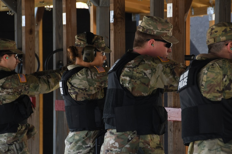 The 104th Fighter Wing Combat Arms Training and Maintenance Instructors ensure Infantrymen from 1st Battalion, 182nd Infantry Regiment, Bravo Company are currently qualified on the M9 pistol. The Massachusetts National Guard Infantrymen are activated in response to COVID-19 to ensure there is enough manpower available to safeguard the 104th Fighter Wing assets and personnel. These precautions are being taken to mitigate any manning shortages that may occur due to unforeseen illness and will allow back up for the wing's Security Forces. During the pandemic, the infantrymen will be working alongside the 104th Security Forces to reinforce security for the 104th Fighter Wing F-15 homeland defense flying mission to maintain air superiority.(U.S. Air National Guard Photo by Senior Master Sgt. Julie Avey)