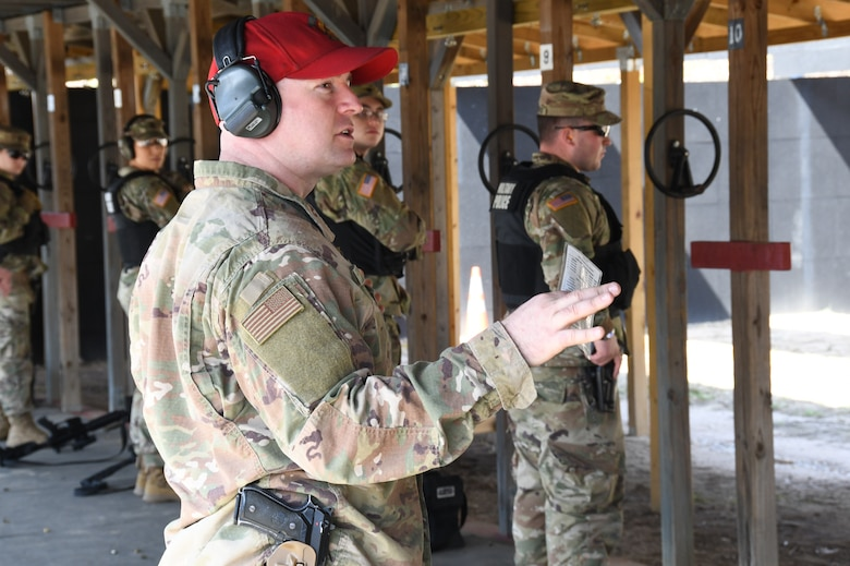Master Sgt. Christopher Jones, 104th Fighter Wing Combat Arms Training and Maintenance Instructor calls out commands on the firing line to ensure the Infantrymen from 1st Battalion, 182nd Infantry Regiment, Bravo Company, are currently qualified on the M9 pistol. The Massachusetts National Guard Infantrymen are activated in response to COVID-19 to ensure there is enough manpower available to safeguard the 104th Fighter Wing assets and personnel. These precautions are being taken to mitigate any manning shortages that may occur due to unforeseen illness and will allow back up for the wing's Security Forces. During the pandemic, the infantrymen will be working alongside the 104th Security Forces to reinforce security for the 104th Fighter Wing F-15 homeland defense flying mission to maintain air superiority. (U.S. Air National Guard Photo by Senior Master Sgt. Julie Avey)