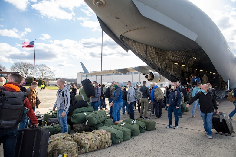 Members of 801st Combat Support Hospital, U.S. Army Reserve, Fort Sheridan, Illinois, arrive on Hanscom Air Force Base