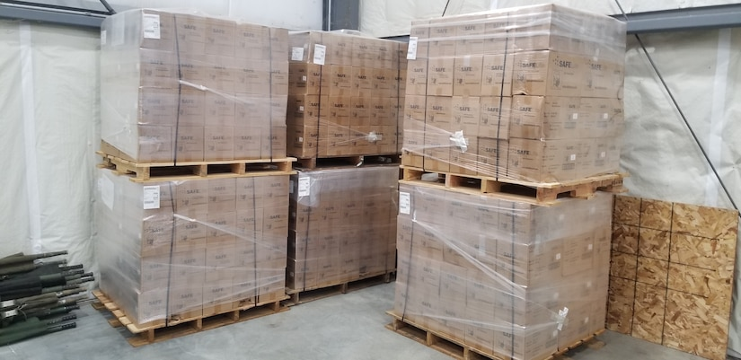 Pallets of N95 masks await use at U.S. Transportation Command's Patient Movement Item Center after joint efforts by the Defense Security Cooperation Agency, the Defense Logistics Agency and TRANSCOM.