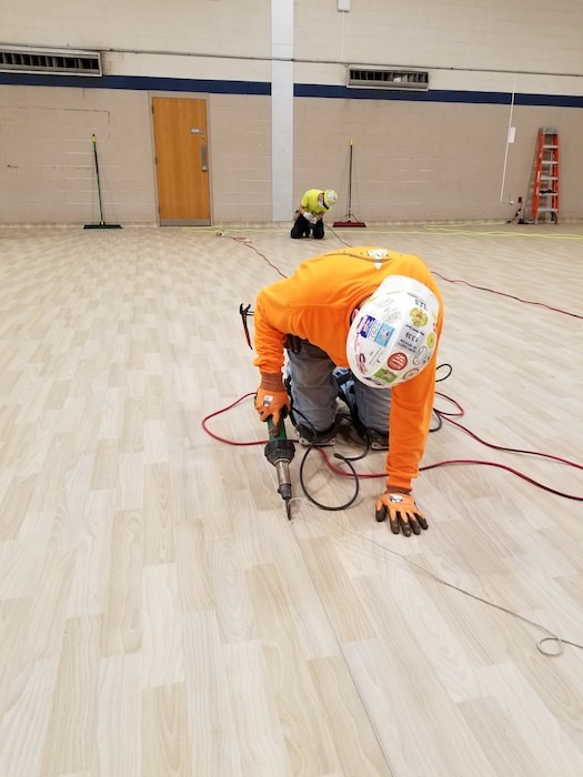 Contractors work on flooring as part of construction at the Bergen New Bridge Medical Center in Paramus, N.J. USACE is working with FEMA and the state to expand capacity at medical facilities as part of the ongoing response to the COVID-19 Pandemic.