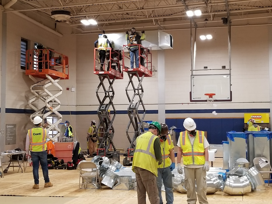 Contractors work on lighting and HVAC as part of construction at the Bergen New Bridge Medical Center in Paramus, N.J. USACE is working with FEMA and the state to expand capacity at medical facilities as part of the ongoing response to the COVID-19 Pandemic.